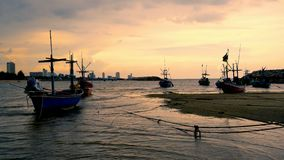 Small fishing boat in the pier. At sunset time Thailand stock footage