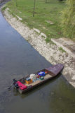 Small fishing boat in river channel 2 Stock Photo
