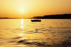 Small fishing boat on river danube in sunset Stock Image