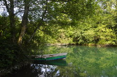 Small fishing boat on river in france stock photo