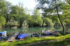 Small fishing boat on river in france stock images