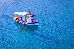 Small fishing boat on the sea stock photos