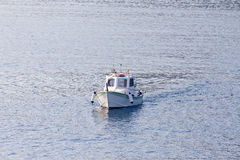 Small fishing boat in the sea Stock Photo