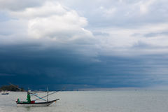Small fishing boat on the sea Storm is coming Stock Photo