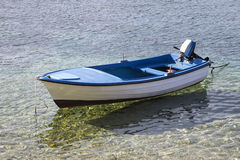 Small fishing boat on the sea in a summer day Royalty Free Stock Photos