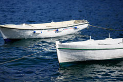 Small fishing boat on the sea water in a sea bay Stock Photo