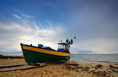 Small fishing boat on shore of the Baltic Sea in Gdynia,. Royalty Free Stock Images