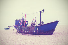 Small fishing boat on shore of the Baltic Sea. Royalty Free Stock Image