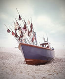 Small fishing boat on shore of the Baltic Sea. Stock Photos