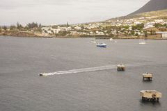 Small Fishing Boat Speeding Across a Harbor Stock Images