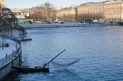Small fishing boat in Stockholm downtown Stock Image