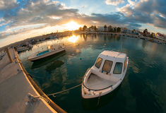 Small fishing boat at sunset Stock Images
