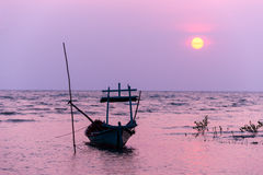Small fishing boat at sunset in the sea Royalty Free Stock Images