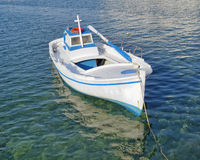 Small fishing boat,  turquoise sea Stock Photos