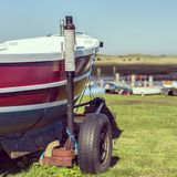 Small fishing boat. Small fishing vessel docked on land at a marine in the Uk Stock Image