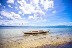 Small Fishing boat on white tropical beach Royalty Free Stock Image
