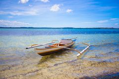 Small Fishing boat on white tropical beach Royalty Free Stock Photography