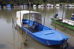 Fishing Boats Anchored at Rivers Shore stock photography
