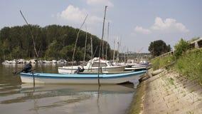 Fishing Boats Anchored at Rivers Shore royalty free stock photos