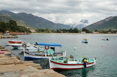 Small fishing boats in the bay of Sagone Stock Images