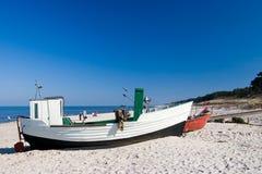 Small fishing boats on beach stock photo