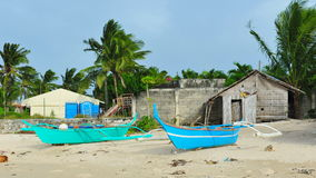 Small fishing boats on the beach of Bantayan Island Stock Images