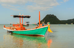 Small fishing boats in the beach Stock Photos