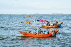 Small fishing boats on the beach Stock Photos