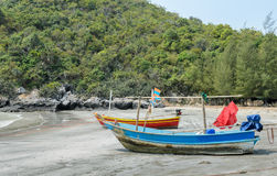 Small fishing boats on beach in Thailand Stock Photos