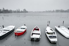 Small boats caught in the ice royalty free stock image