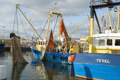 Small fishing boats in the Dutch port Stock Photo