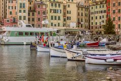 Small fishing boats and ferry in Camogli royalty free stock photography