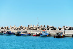 Small fishing boats in the harbor of Sisi, Crete royalty free stock images