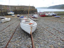 Small fishing boats in harbour. Small fishing boats and dinghies in the port of Clovelly in Devon, England Royalty Free Stock Image