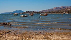 Small fishing boats on a lake Royalty Free Stock Photography
