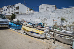 Small fishing boats on land. Image is shot just off the beach at Burgau in Portugal royalty free stock photo