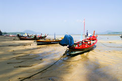 Small fishing boats landing beach Royalty Free Stock Photo