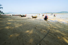 Small fishing boats landing beach. Small fishing boats landing sand beach blue sky Stock Images