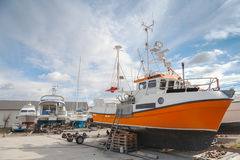 Small fishing boats lay on the coast Stock Photography