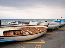 Small fishing boats lying on the shoreline Royalty Free Stock Photography