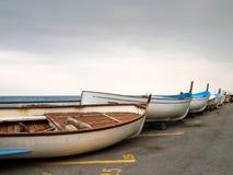 Small fishing boats lying on the shoreline Royalty Free Stock Photo
