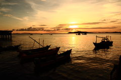 Small Fishing Boats Marina at Sunset in the East of Thailand. Small Fishing Boats Marina at Sunset in the East, Thailand stock images
