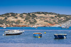Small fishing boats off the coast in one of the bays. Royalty Free Stock Image