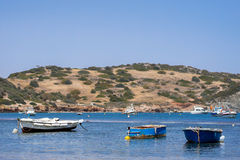 Small fishing boats off the coast in one of the bays. Stock Photo