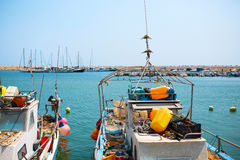 Small fishing boats in port with fishing net Stock Photos