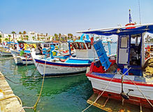 Small fishing boats in the port of Kos in Greece. Kos, Greece - July 31, 2015: In the port of Kos in Greece some small fishing boats are moored after returning royalty free stock images