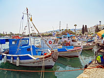 Small fishing boats in the port of Kos in Greece. Kos, Greece - July 31, 2015: In the port of Kos in Greece some small fishing boats are moored after returning Royalty Free Stock Image