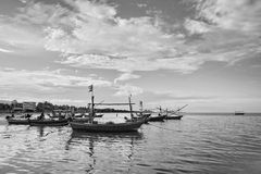 Small fishing boats in the sea Stock Images