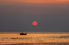 Small Fishing Boats on sea in sunset. Silhouette  small Fishing Boats on sea in sunset royalty free stock photos