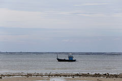 Small fishing boats in seaside of Coast on time low tide and sky Royalty Free Stock Photo
